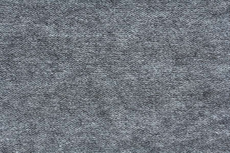 Knitted gray fabric texture, reverse stockinette stitch