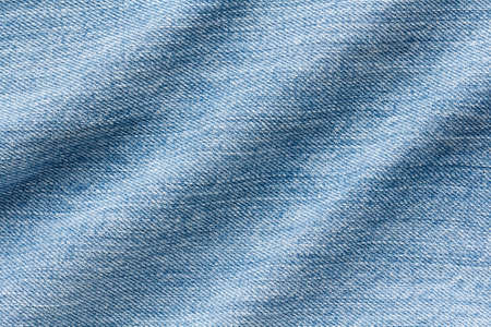 denim fabric with folds, textile background