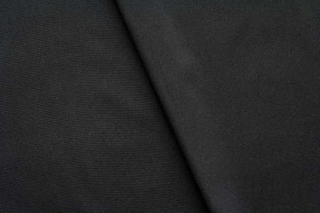 black fabric with diagonal fold