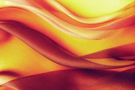 yellow red fabric with large folds,  abstract background