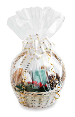 gift basket packed in transparent paper with a big bow isolated on a white background