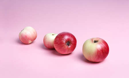 apples on a pink background with place for text Stock fotó