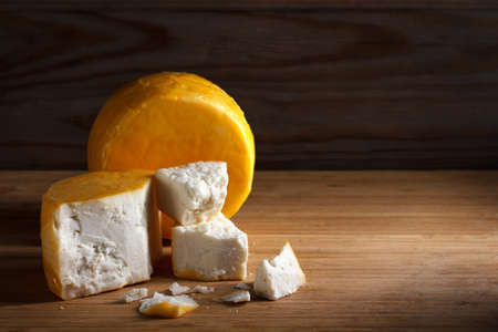 goat cheese on a wooden background with copy space