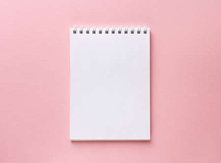 Open notebook on pastel pink