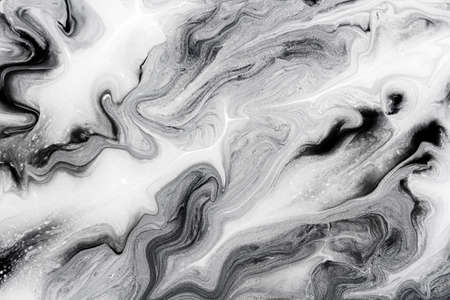 marble texture formed by mixing the black and white acrylic paint, abstract background