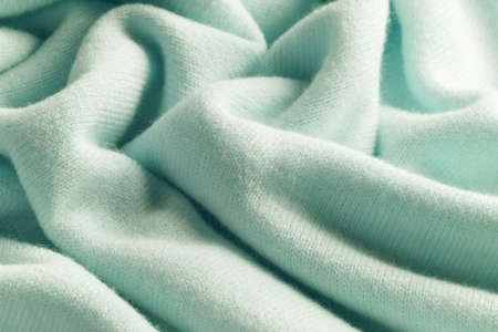 Knitted cashmere green fabric texture with large fold Stock fotó