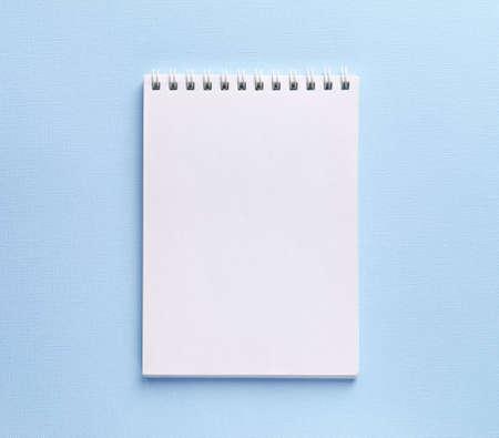 Open notebook on light blue