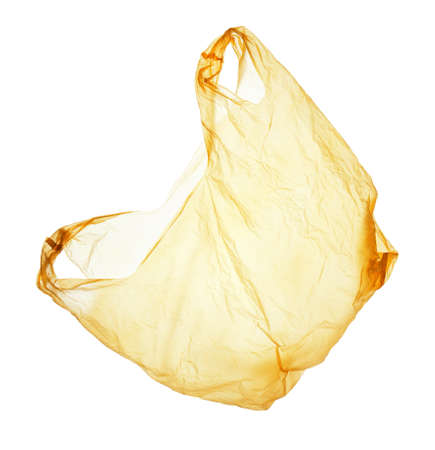 flying yellow polyethylene bag isolated on white background Stock fotó