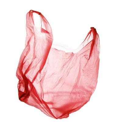 Flying red used polyethylene bag isolated on white Stock fotó