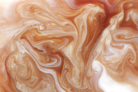 Mixing coffee with milk, macro