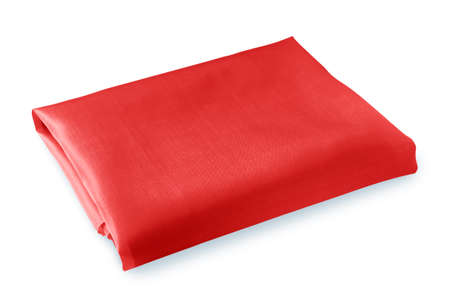 folded piece of bright red fabric isolated on white background