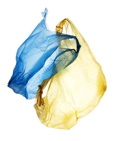 flying blue and yellow used polyethylene bags isolated on white background