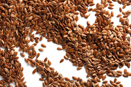 flax seeds scattered on a white background, macro