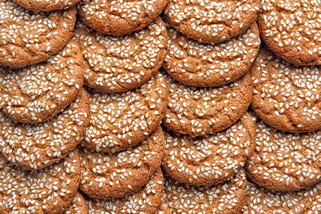 oatmeal cookies with sesame seeds as a food background