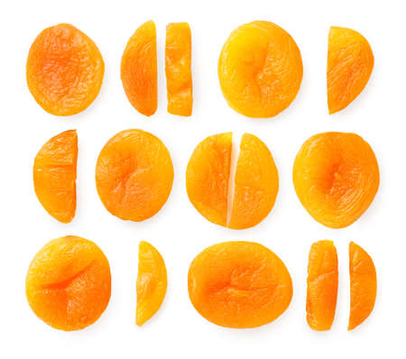 Different varieties of whole and sliced dried apricots isolated on white 免版税图像