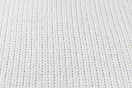 Knitted white fabric texture in perspective, stockinette stitch