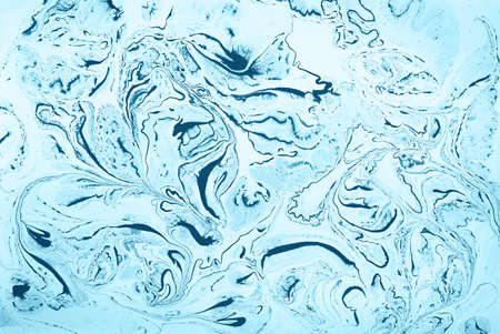 Abstract marble background of mixing blue white paints