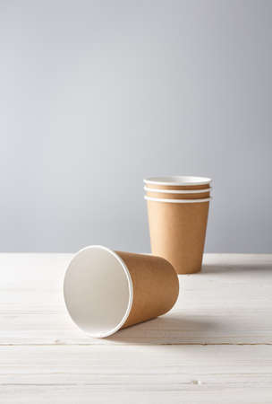 two eco paper cups on white wooden background with place for text 免版税图像