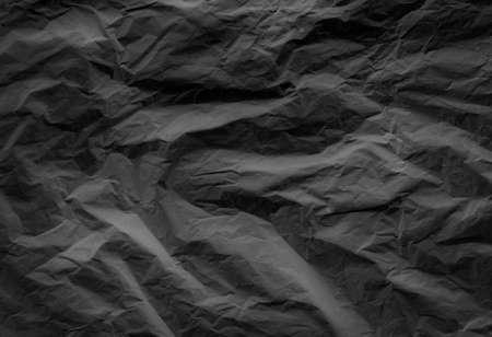black crumpled paper texture background