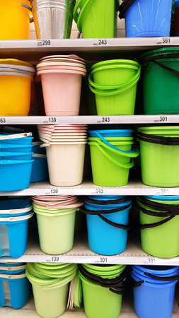 bright color plastic buckets on sale in a store 免版税图像