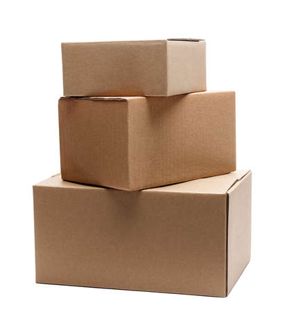 stack of three cardboard boxes of different sizes isolated on white