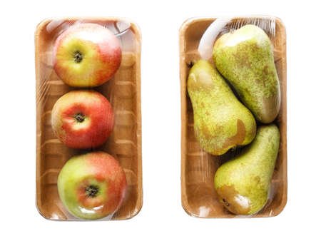 apples and pears packaged in cardboard containers wrapped in cling film for retail sale, isolated on white