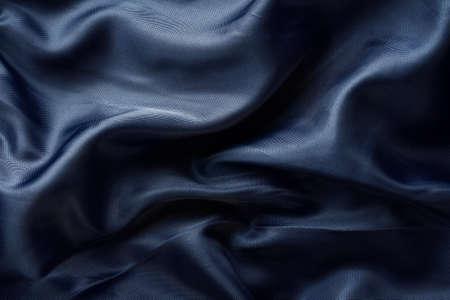dark blue fabric with large folds Foto de archivo
