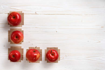 red apples on a white wooden table, flat lay, with copy space Reklamní fotografie