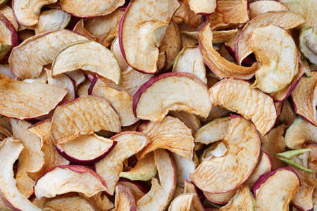 heap of homemade dried apple slices close up as food background