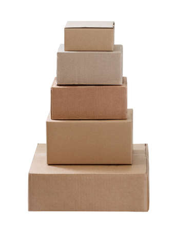 stack of three cardboard boxes of different sizes isolated on white background 免版税图像