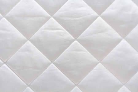 white cotton quilted fabric macro, textile background 免版税图像