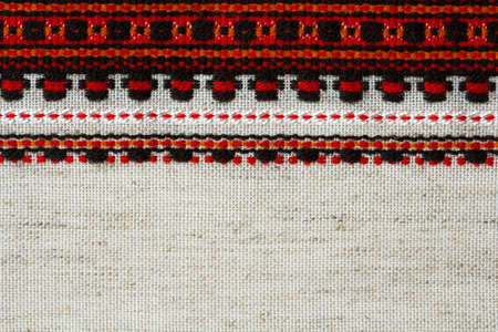 Ukrainian folk decorative embroidery on linen fabric