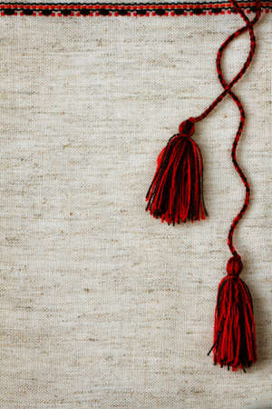 linen fabric with embroidered trim and tassels