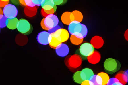 colorful rainbow christmas bokeh lights on a black background