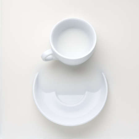 white coffee cup and saucer with milk