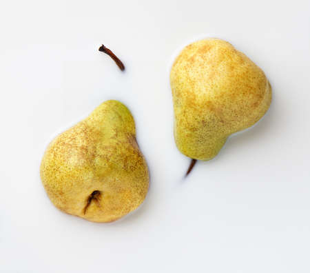 two yellow ripe pears pham, top view