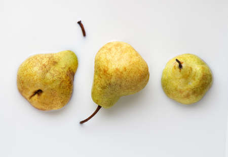 three yellow ripe pears pham, top view