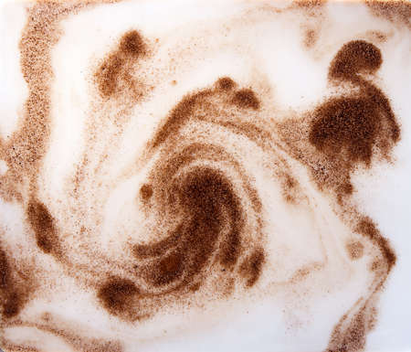 mixing coffee or chicory powder with milk, macro