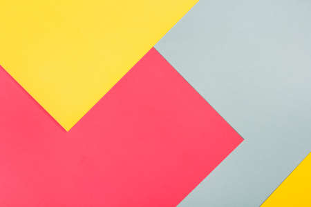 geometric flat lay composition of bright colored paper