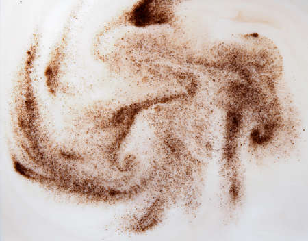 mixing coffee or chicory powder with milk, abstract background 免版税图像