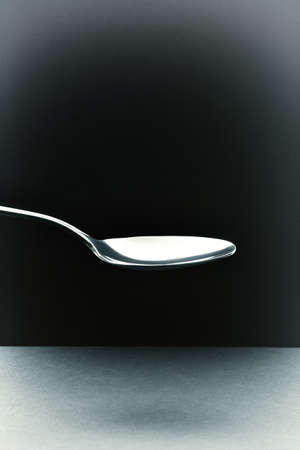 empty tablespoon on a black background