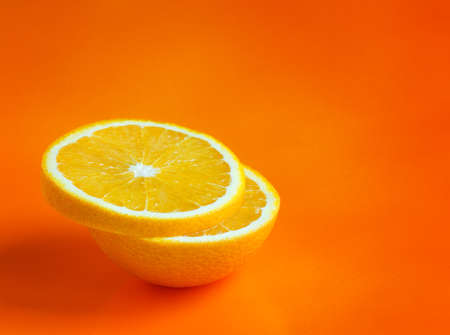 lemon slices on orange background