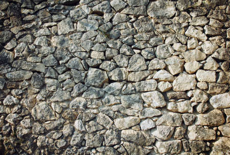 wall of beige natural stones, rubble masonry 免版税图像