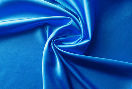 bright blue satin fabric with swirl folds