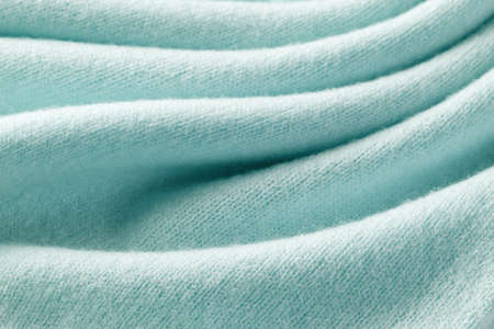 Knitted cashmere turquoise fabric texture with large fold