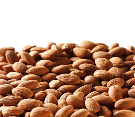 whole almonds on white background with copy space