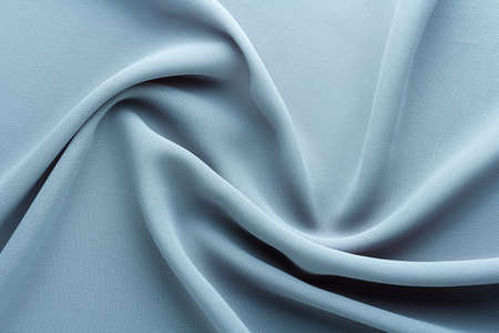 light blue fabric draped with curl folds, textile background Stock fotó