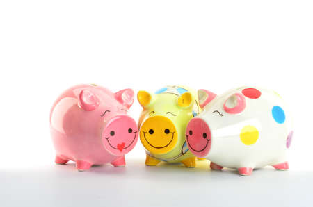 colorful piggy banks isolated on white background photo