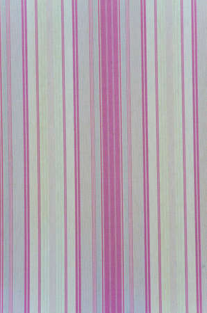 Background texture of a curtain with rose vertical lines photo