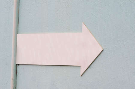 elongated: pink elongated arrow, rough bluish background for graphic tube